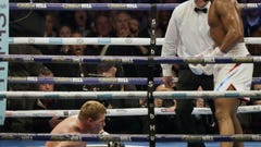 Joshua stops Povetkin in 7th round, keeps heavyweight titles