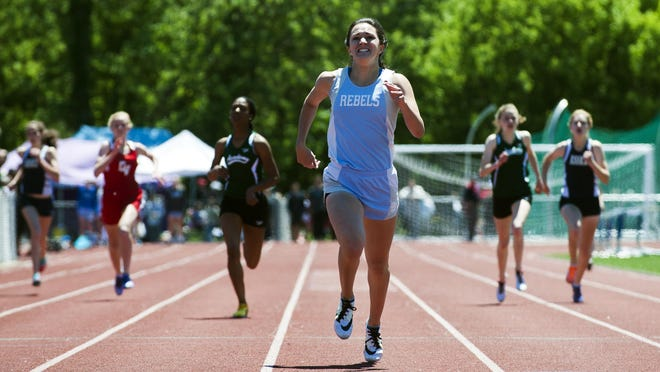 South Burlington's Kayla Gilding races to one of her four individual wins at Saturday's Division I high school track and field championships at Burlington High School.