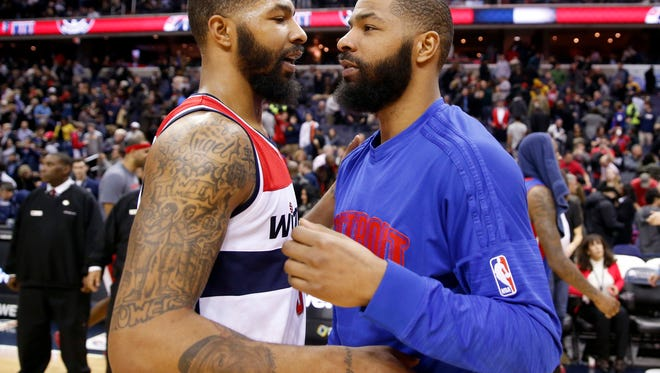 Wizards forward Markieff Morris, left, and Pistons forward Marcus Morris talk on the court after the game on Feb. 19, 2016, in Washington. The Wizards won, 98-86.