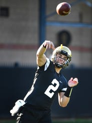 Quarterback Deuce Wallace throws during Vanderbilt's first practice of spring on Monday.