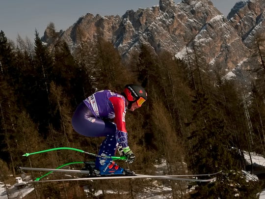 Stacey Cook goes airborne during a training session of the alpine skiing, women's World Cup downhill in Cortina d'Ampezzo, northern Italy on Jan. 18.