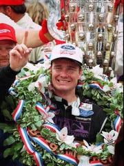 Buddy Lazier celebrates in Victory Lane after winning the Indianapolis 500 at the Indianapolis Motor Speedway, May 26 1996.