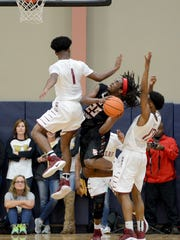 South Side's Geordan Reed draws a foul while going up for a shot during Tuesday night's Region 7-AA semifinal game against Crockett County. South Side defeated Crockett County, 70-37.