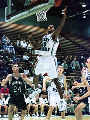 12/21/99-Perry MeridianÕs #20 Andre Owens recovers a rebound during MeridianÕs home game against Monrovia. (Mpozi Mshale Tolbert Photo)