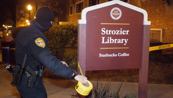 A TPD officer sets up a perimeter next to Strozier library on the main campus of Florida State University on Thursday, Nov. 20, 2014 in Tallahassee, Fla.