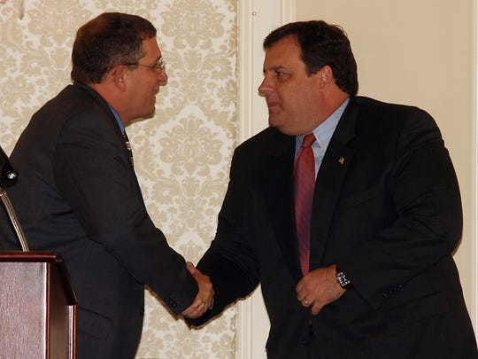 In a 2006 file photo, Arthur Ondish, Summit Chairman and Morris Tomorrow trustee, shakes hands with Keynote Speaker and future New Jersey Governor Chris Christie during Morris Tomorrow's 7th annual summit.