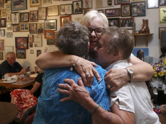 """Longtime customer and retired teacher Lucy Philbrick, center, hugs Klassique Kafe owners Millie Ellis, left and Kathie Steers, right, Monday at the restaurant in Redding. Sisters Ellis and Steers have owned and run the restaurant for 31 years that is closing on Friday. """"These two are pure love,"""" Philbrick said. """"They are always welcome to everybody."""""""