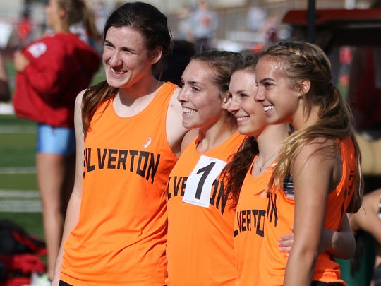 Silverton's 4000m relay team poses for a picture on Friday, April 15, 2016, during the Vikings Relays Twilight Invitational track and field meet at North Salem High School.