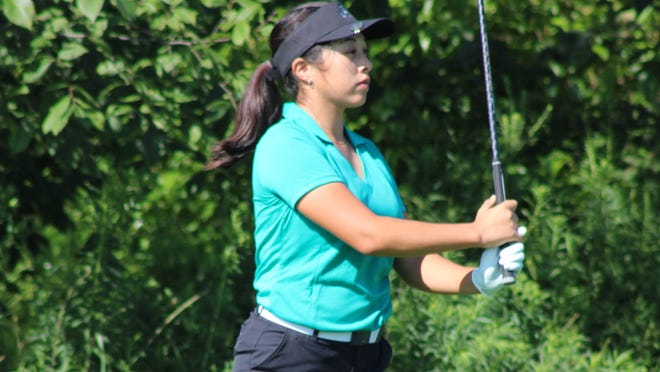 Brooklyn Millard focuses on her shot during the first of four Suburban League tournaments Thursday at Gleneagles Golf Club in Twinsburg. Millard finished third overall and Aurora placed third in the team standings.
