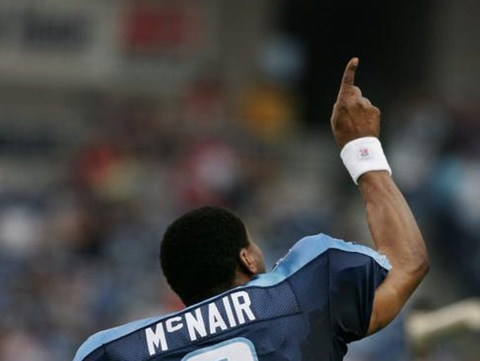 Tennessee Titans quarterback Steve McNair points to the sky as he is introduced before their game against the Tampa Bay Buccaneers at the Coliseum for a preseason game Aug. 12, 2005.