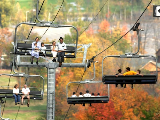 Visitors take sightseeing to the air as they tour the fall colors from the chair lifts at Granite Peak Ski Area.