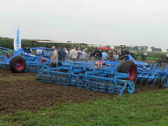 Attendees looked at farm equipment adapted to organic farming.