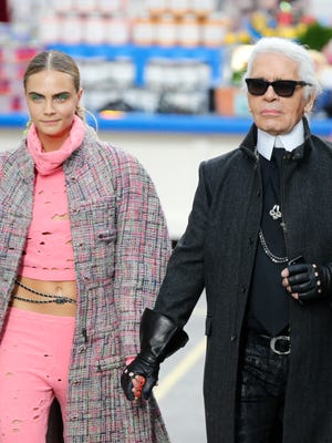 The maestro and his muse: Karl Lagerfeld and Cara Delevingne at the Chanel show in Paris on March 4.