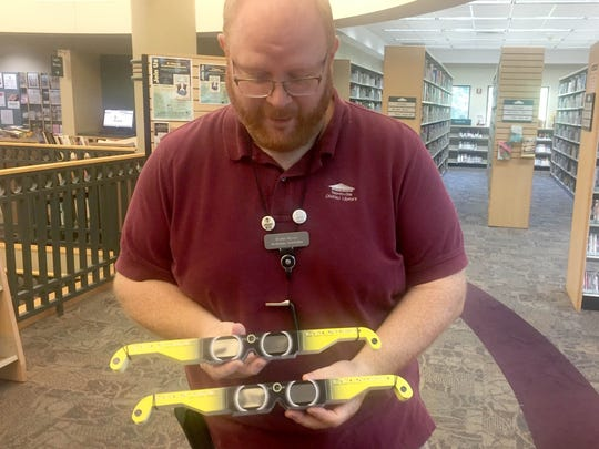 Technical coordinator at the Northville Public Library Michael McEvoy holds the hot commodity in his hands.