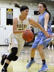 Alamogordo's Daniella Martinez, left, dribbles past a Goddard defender towards the basket.