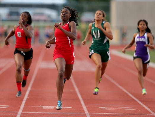 Pike's Lynna Irby wins the 200 meter dash during the IHSAA girls track regional at Ben Davis High School, Tuesday, May 27, 2014, in Indianapolis.