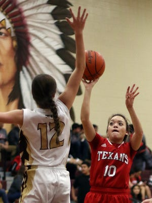 Ray's Alyssa Viera (10) shoots over the outstretched arm of Tuloso-Midway's Mackenzie Hermes (12) during their District 30-5A North Zone Game in Bobby Craig Gymnasium on Tuesday, January 21, 2017.