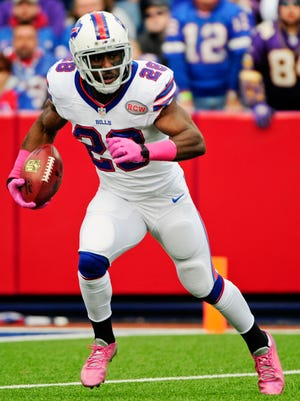 FILE - In this Sunday, Oct. 19, 2014 file photo, Buffalo Bills running back C.J. Spiller (28) returns a punt during the first half of an NFL football game against the Minnesota Vikings in Orchard Park, N.Y. The New Orleans Saints and free agent running back C.J. Spiller agreed to a four-year contract on Friday, March 13, 2015, a move that bolstered a backfield which also includes Mark Ingram and Khiry Robinson. (AP Photo/Gary Wiepert, File)