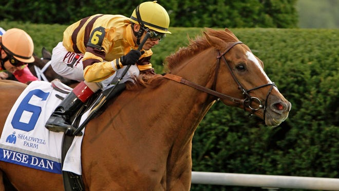 Wise Dan, ridden by jockey John Velazquez, roars to victory in the $1 million Shadwell Turf Mile horse race at Keeneland Race Course in Lexington, Ky., Saturday, Oct. 4, 2014.