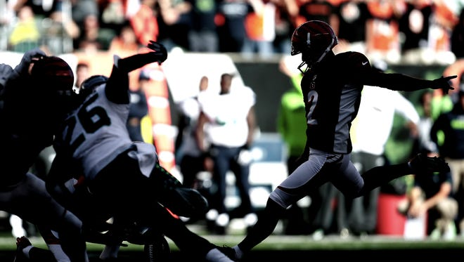 Cincinnati Bengals kicker Mike Nugent (2) kicks the game-winning field goal in overtime of the NFL Week 5 game between the Cincinnati Bengals and the Seattle Seahawks at Paul Brown Stadium in Cincinnati, on Sunday, Oct. 11, 2015. The Bengals advanced to 5-0 with a 27-24 overtime win over Seattle.