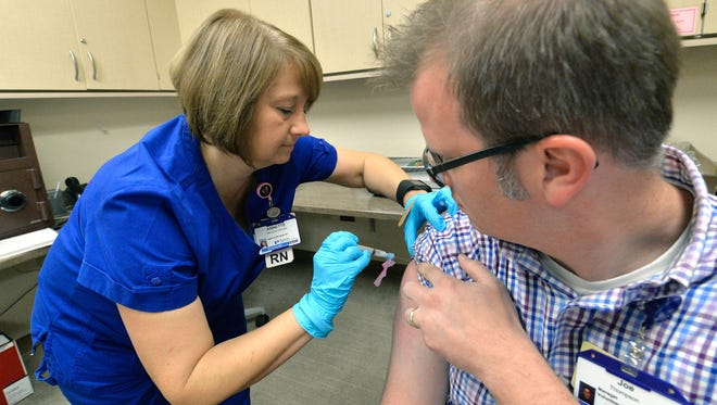 A man gets a flu shot.
