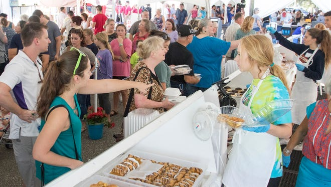 A long line of people wait to place orders for Greek pastries during the 58th annual Greek Festival at the Annuciation Greek Orthodox Church in Pensacola on Saturday, October 14, 2017.