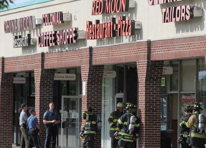 Police and firefighters on the scene of a fire at the Aldrich Plaza Shopping Center on Rt. 9 North in Howell, Monday, June 23, 2014.
