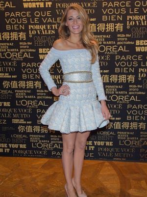 Blake Lively poses at Shangri-La Hotel Paris on Oct. 29, 2013 for the L'Oreal announcement.