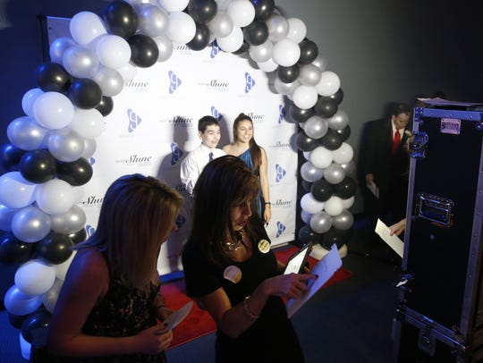 Guests line up for photos during the Night to Shine