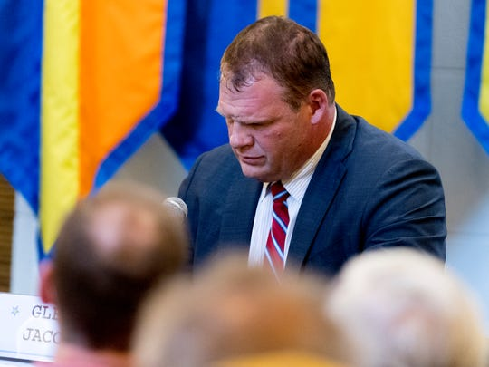 Knox County mayoral candidate Glenn Jacobs reacts after saying he agrees with Knox County Sheriff elect Tom Spangler's support of enforcing of ICE's 287(g) program within the sheriff's department during a Knox County mayoral forum at Pellissippi State Community College on Magnolia Ave. in Knoxville, Tennessee on Friday, July 20, 2018.