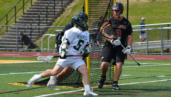 Jake Coleman comes around the crease looking for a goal during the first half of Saturday's NYSPHSAA regional final at Lakeland High School.