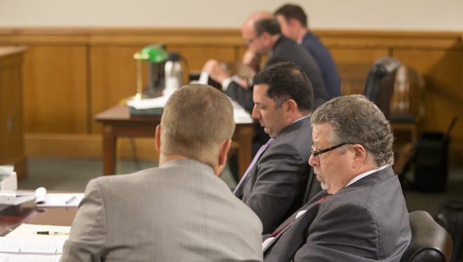 Attorneys wait for an order by Judge Ronald Thompson at the Effingham County Judicial Complex, that unseals sexual misconduct complaint files USA Gymnastics on 54 coaches.
