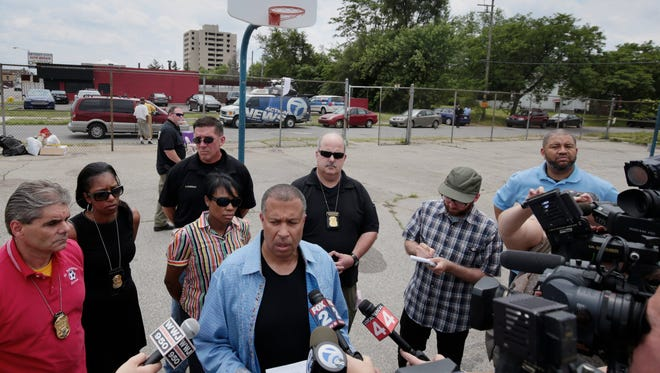 Detroit Police Chief James Craig, center, talks to the media Sunday, June 21, 2015 at the scene where 12 people were shot and one confirmed dead on Saturday evening in Detroit, MI.