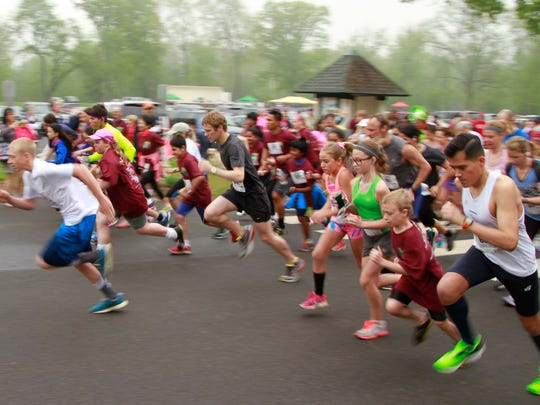 Runners take off at the 2015 Annual Family Fun Walk