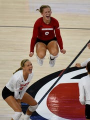 USD's Lauren Mattison and Audrey Reeg (left) react after scoring against UND at the Sanford Coyote Sports Center on Tuesday in Vermillion.