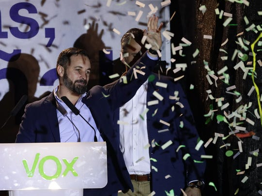 Santiago Abascal, leader of far right party Vox, waves to supporters gathered outside the party headquarters following the general election in Madrid, Sunday.