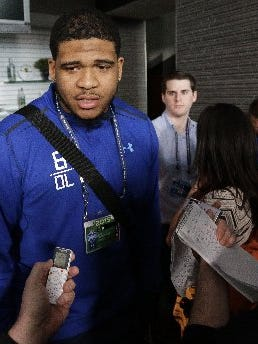 LSU offensive tackle La'el Collins talks to the media at the NFL scouting combine.