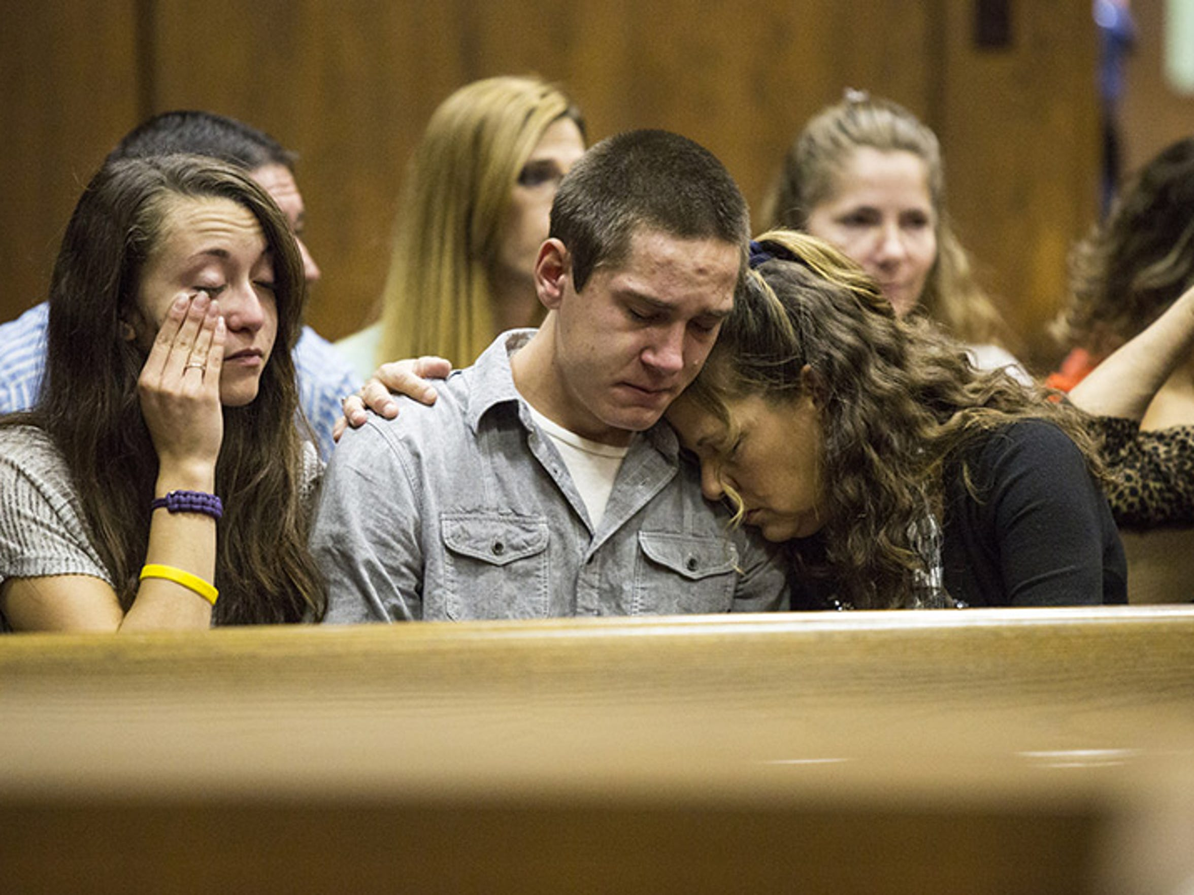 Autumn Arseneau, 18, Zak Roll, 18, and his mother Kellie Roll, 51, of Germfask, listen to testimony about the murders of Arseneau's uncle Jody Hutchinson, 42, and Roll's daughters Carrie Nelson, 31, and Heather Aldrich, 25, during an Oct. 19 court hearing.