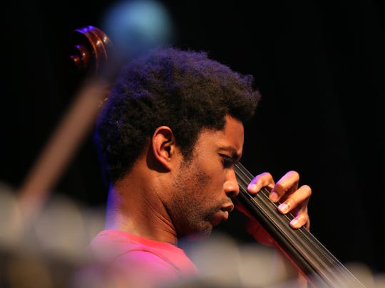 Bassist,  Marcus Miller,  playing with Marquis Hill Blacktet at the Rochester Jazz Festival.