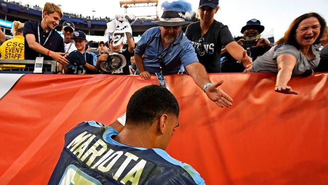 Titans quarterback Marcus Mariota greets fans after the game Sunday, Sept. 24, 2017, at Nissan Stadium. The Titans beat the Seahawks 33-27.