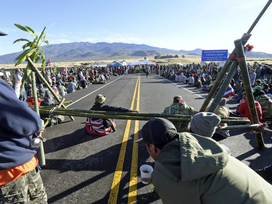 Protesters block the road to Mauna Kea as part of an opposition vigil against the construction of the Thirty Meter Telescope on the sacred summit of Hawaii's tallest mountain, on the Big Island on July 19.