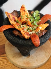 The Guapo Molcajete with steak, chicken, Mexican sausage
