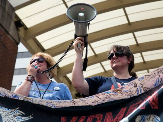 Kimberly Peterson, left, spokesperson for the Women's March Coalition of East Tennessee, and Caroline Mann, board member of the Women's March Coalition of East Tennessee, speak to the crowd during the Stand Against Hate rally in Market Square on Aug. 13, 2017.