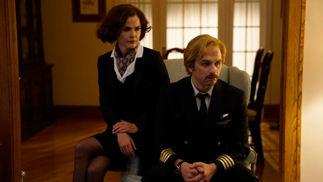 Would you fly with these people? Elizabeth Jennings (Keri Russell) and husband Philip (Matthew Rhys) don disguises in Season 5 of FX's 'The Americans.'