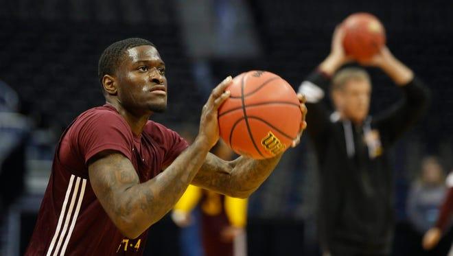 Iona guard A.J. English takes a shot Wednesday, March 16, 2016, during their team practice session before the first round of the NCAA basketball tournament in Denver.