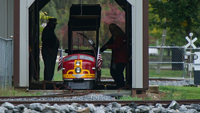 Gypsy Express operators examine the mini-train after a young child was injured when it derailed at Gypsy Hill Park on Saturday, Oct. 11, 2014. The four-year-old boy lacerated his nose but received no further injuries.