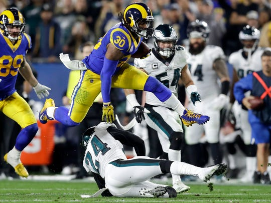 FILE - In this Dec. 16, 2018, file photo Los Angeles Rams running back Todd Gurley runs against the Philadelphia Eagles during the first half in an NFL football game in Los Angeles. Gurley loved to attend the Super Bowl as a fan the past few years. Now that he finally gets to play in it with the Rams, the star running back doesn't even care if he's sharing carries with C.J. Anderson.  (AP Photo/Marcio Jose Sanchez, File)