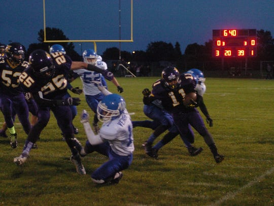 Kewaunee's Lamarco Crawford makes a run up the side lines during the home game against Wrightstown.