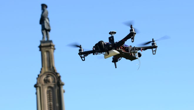 A drone piloted by Ian Nott hovers Jan. 8 near the Confederate monument at Forsyth Park in Savannah, Ga.