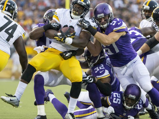 Pittsburgh Steelers' Kevin Fogg is stopped by the Minnesota Vikings defense during the first quarter of the 2015 NFL Hall of Fame Game on Sunday.